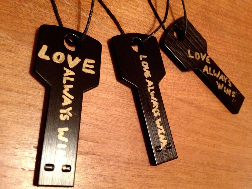 LOVE ALWAYS WINS - USB MP3 Key Necklace